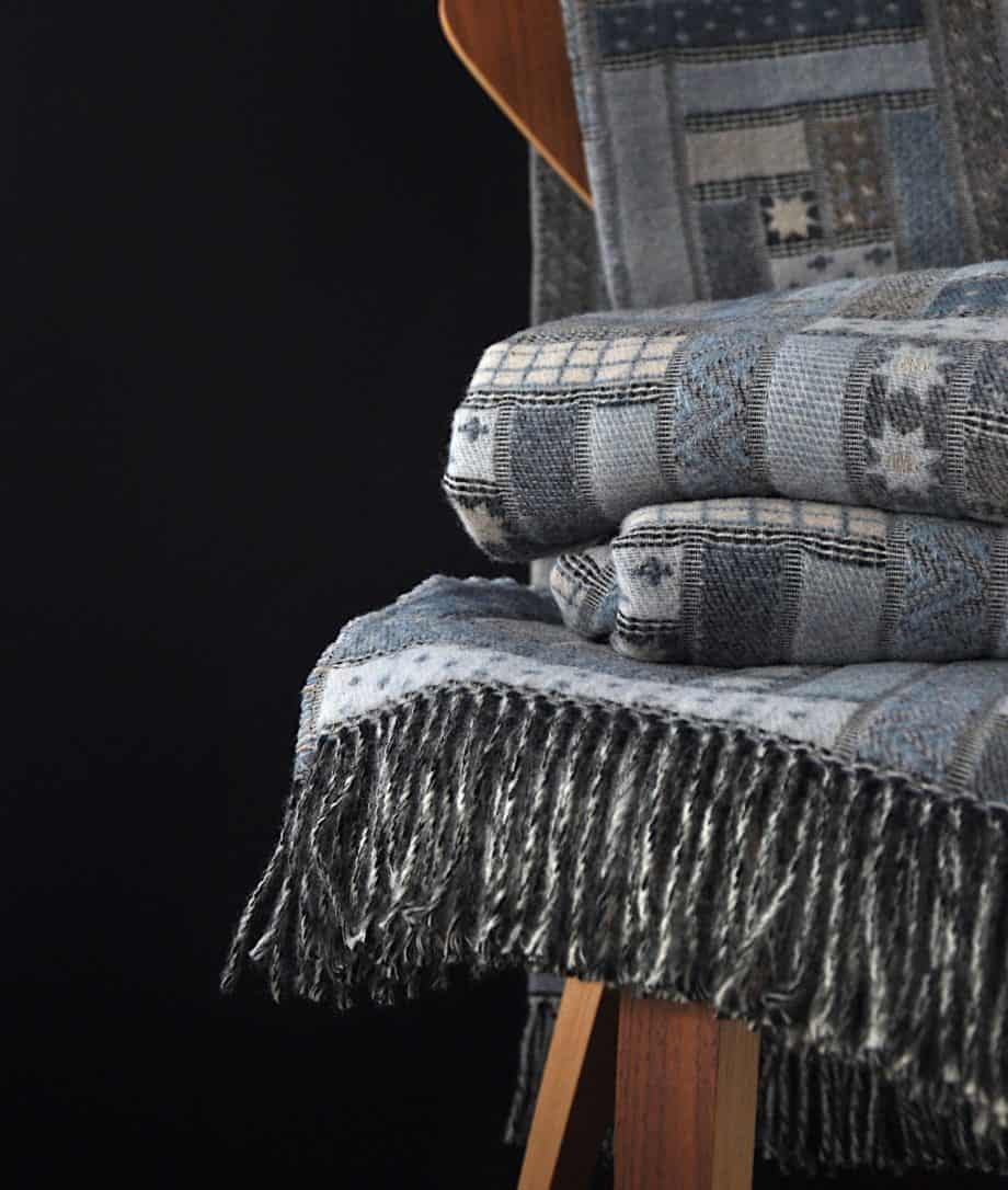 log cabin patchwork blue sofa throw woven from soft merino wool