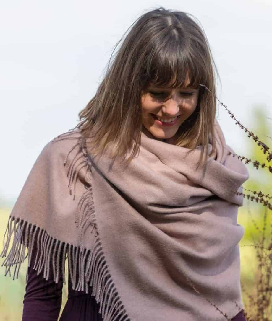 lifestyle picture with baby alpaca wool shawl wrap so cosy collection