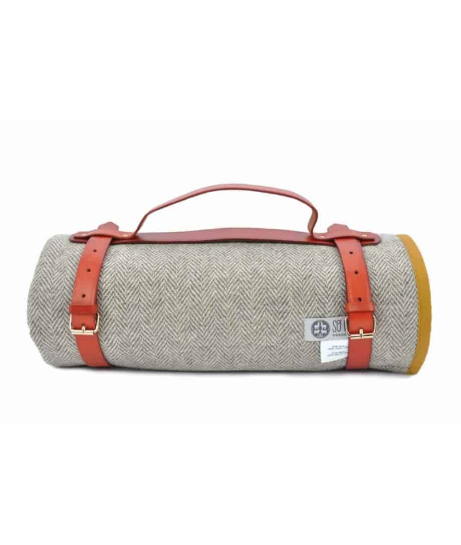 mustard colour wax cotton and wool roll up picnic blanket by so cosy