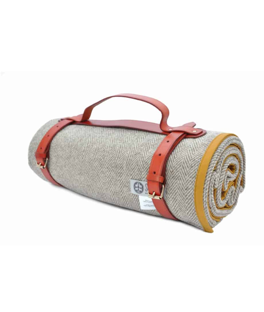 roll up picnic blanket in mustard colour with leather straps