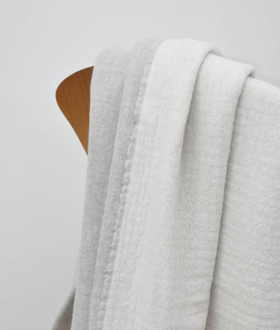light grey and white colour reversible merino wool blanket