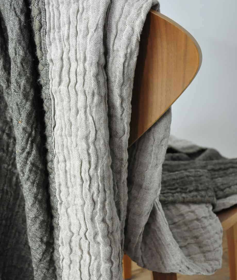 so cosy natural linen and wool mix throw with decorative blanket stitch UK