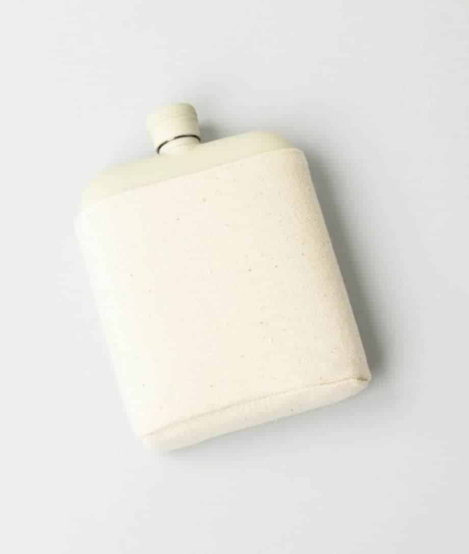 stainless steel flask in canvas carrier