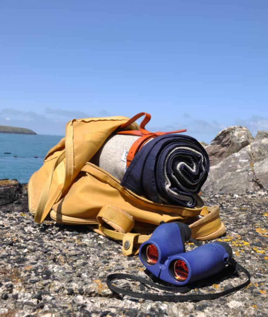 hiking welsh coastline with so cosy picnic blanket