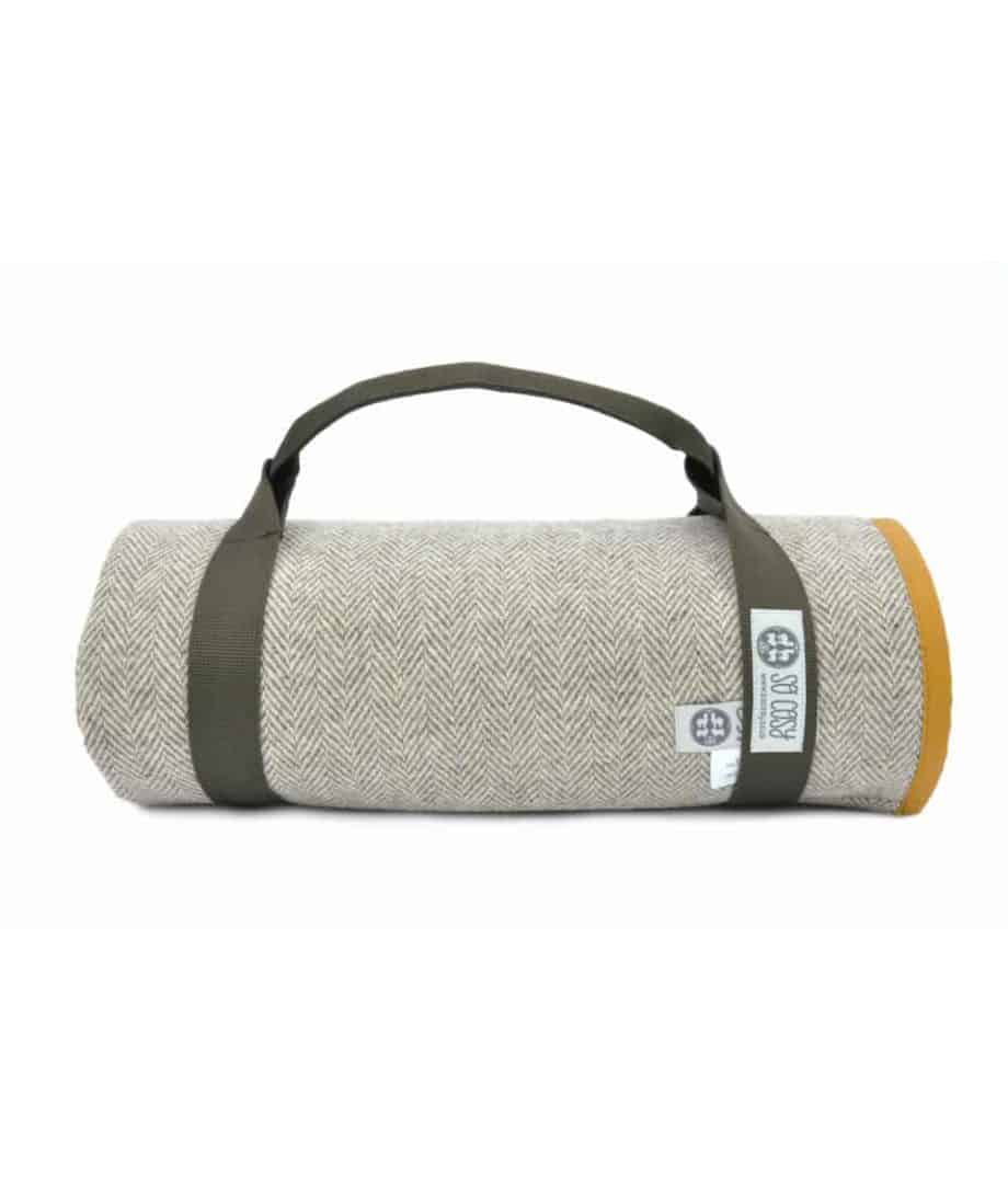 mustard colour waxed cotton and pure wool roll up picnic blanket by so cosy