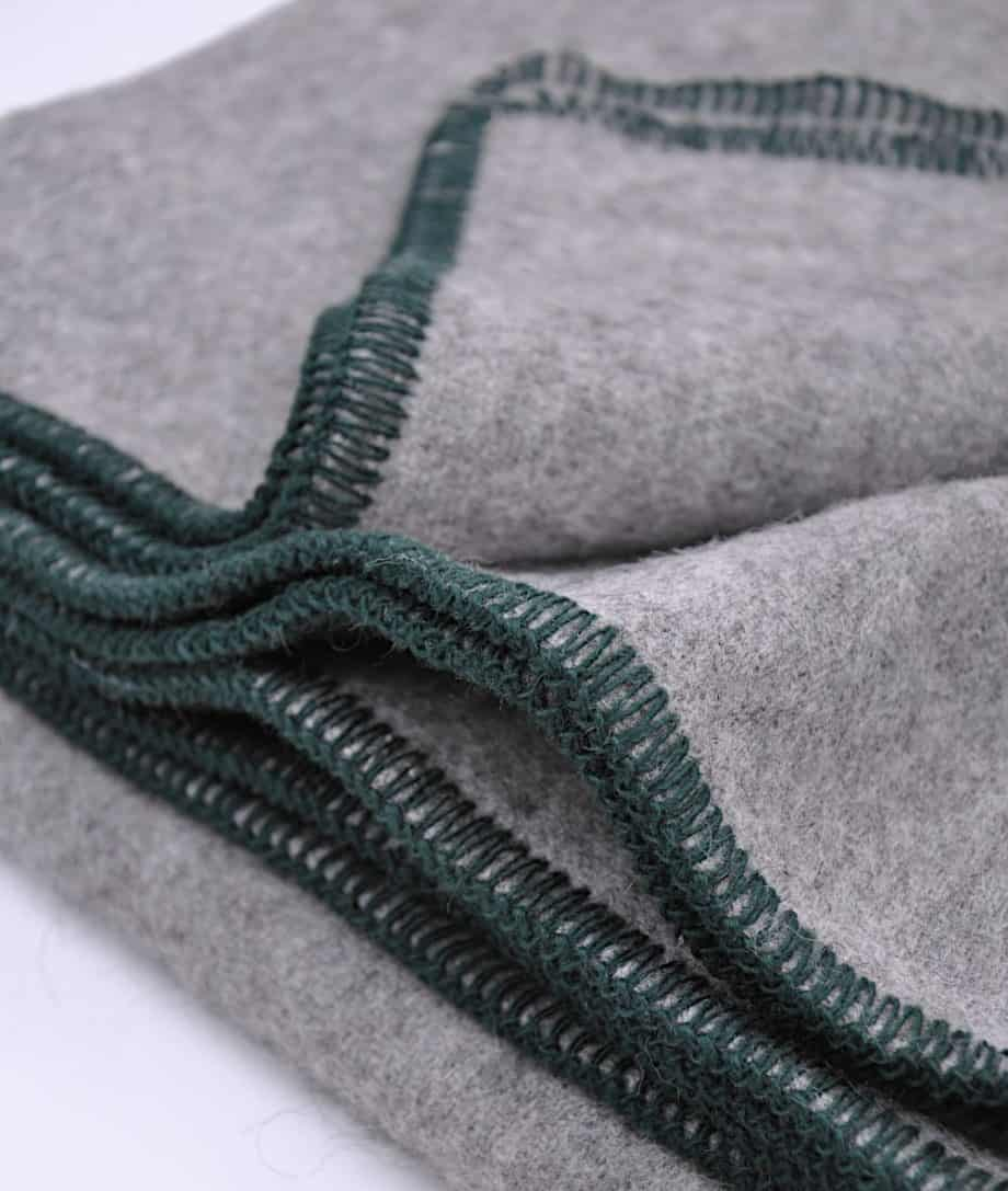 cosy-grey-throw-with-blanket-stitch-green